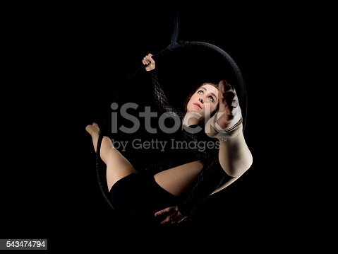 629965740 istock photo Graceful aerial dancer woman isolated on black 543474794