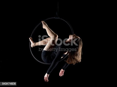629965740 istock photo Graceful aerial dancer woman isolated on black 543474826