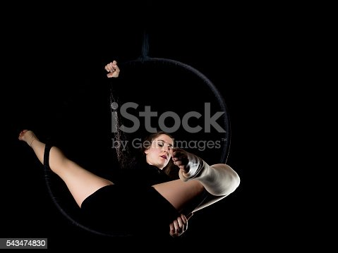 629965740 istock photo Graceful aerial dancer woman isolated on black 543474830