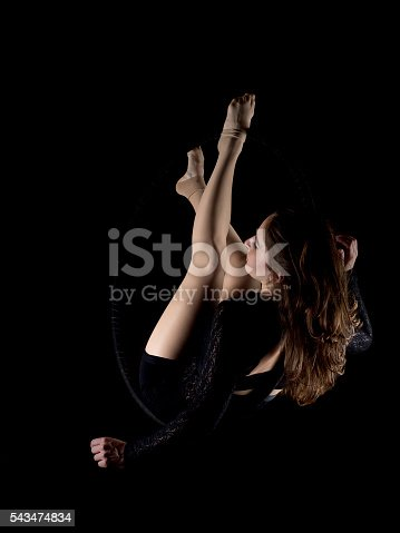 629965740 istock photo Graceful aerial dancer woman isolated on black 543474834