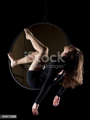 629965740 istock photo Graceful aerial dancer woman isolated on black 543474836