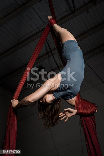 629965740 istock photo Graceful aerial dancer woman training at the circus 543474790