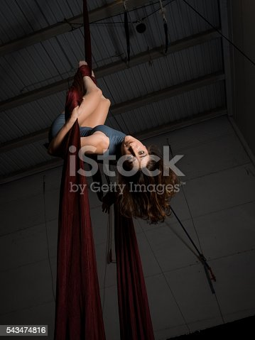 629965740 istock photo Graceful aerial dancer woman training at the circus 543474816
