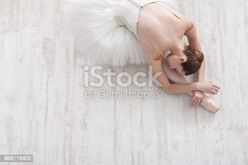 istock Graceful Ballerina stretching, ballet background, top view 866118920
