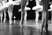 Graceful ballerinas feet dancing on pointe on stage during a performance