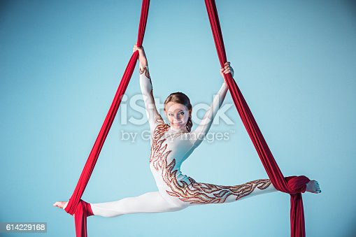 istock Graceful gymnast performing aerial exercise 614229168