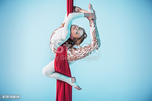 istock Graceful gymnast performing aerial exercise 619740618