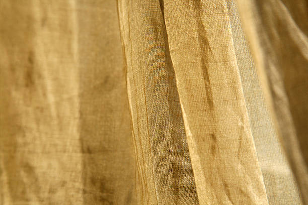 Graceful Linen Fabric Blowing in a Summer Breeze stock photo