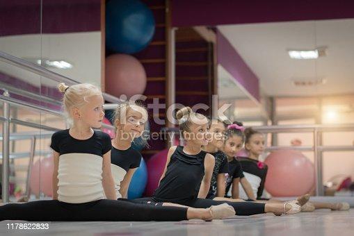 Graceful little ballet Girls doing the splits