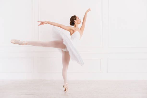 graceful woman standing in ballet position - leotard stock pictures, royalty-free photos & images