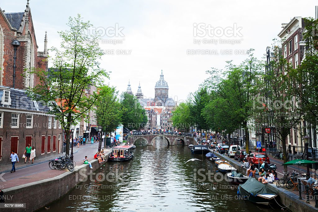 Gracht Voorburgwal and Basilica of St. Nicolas stock photo