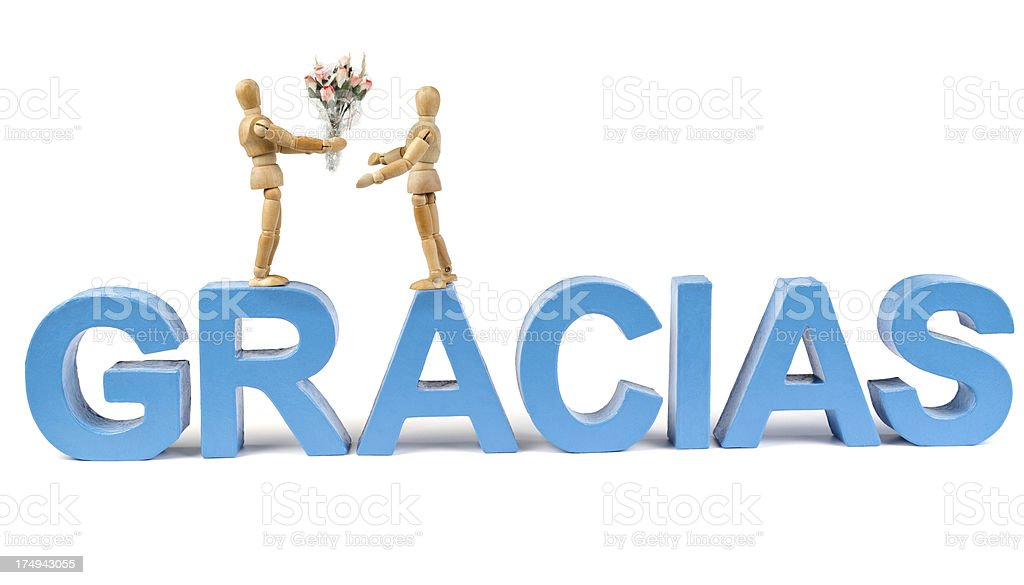 Gracias - Wooden Mannequin demonstrating this word stock photo
