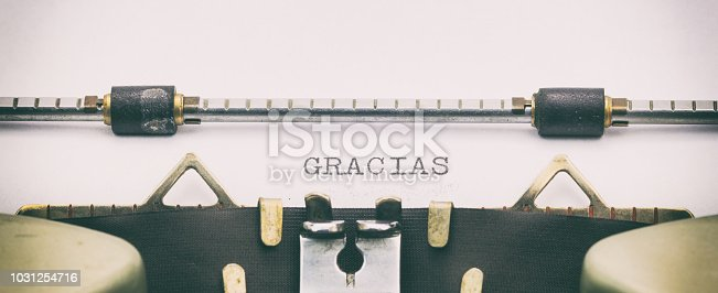 513601840 istock photo Gracias word in capital letters on white sheet 1031254716