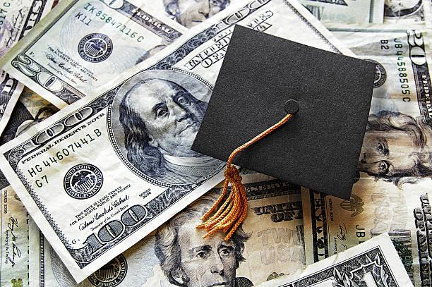 Grad cap on cash stock photo