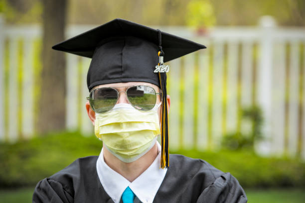 2020 grad in sunglasses and face mask - sdominick stock pictures, royalty-free photos & images