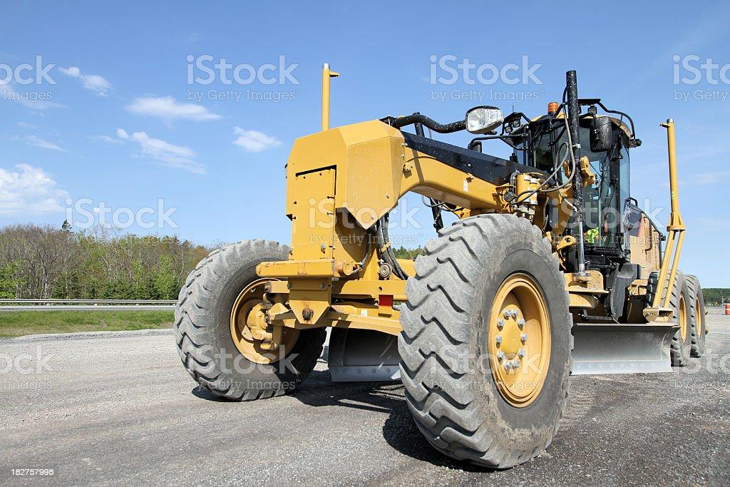 Grader grading asphalt for road stock photo