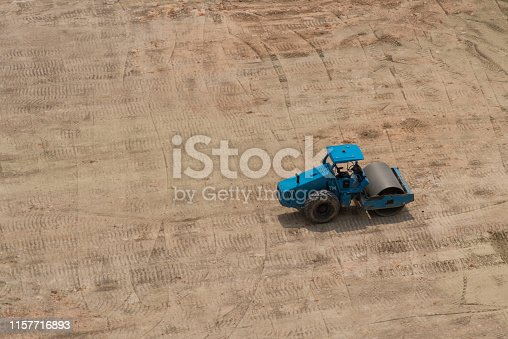 Grader, heavy truck working on construction site