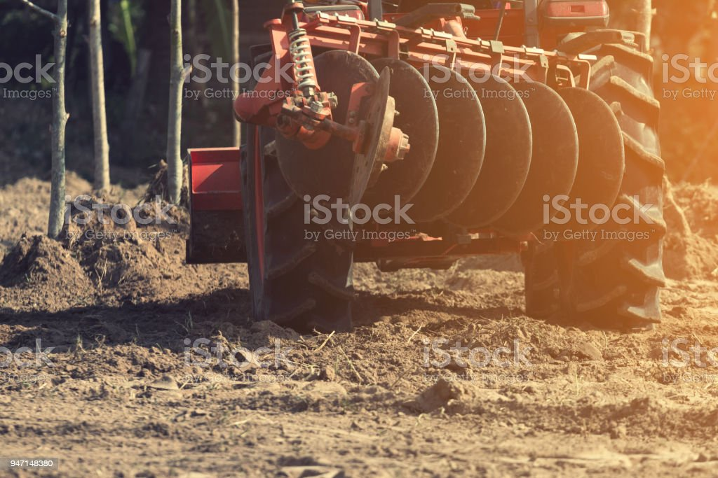 Grader leveling landfill on construction site before kick off project stock photo