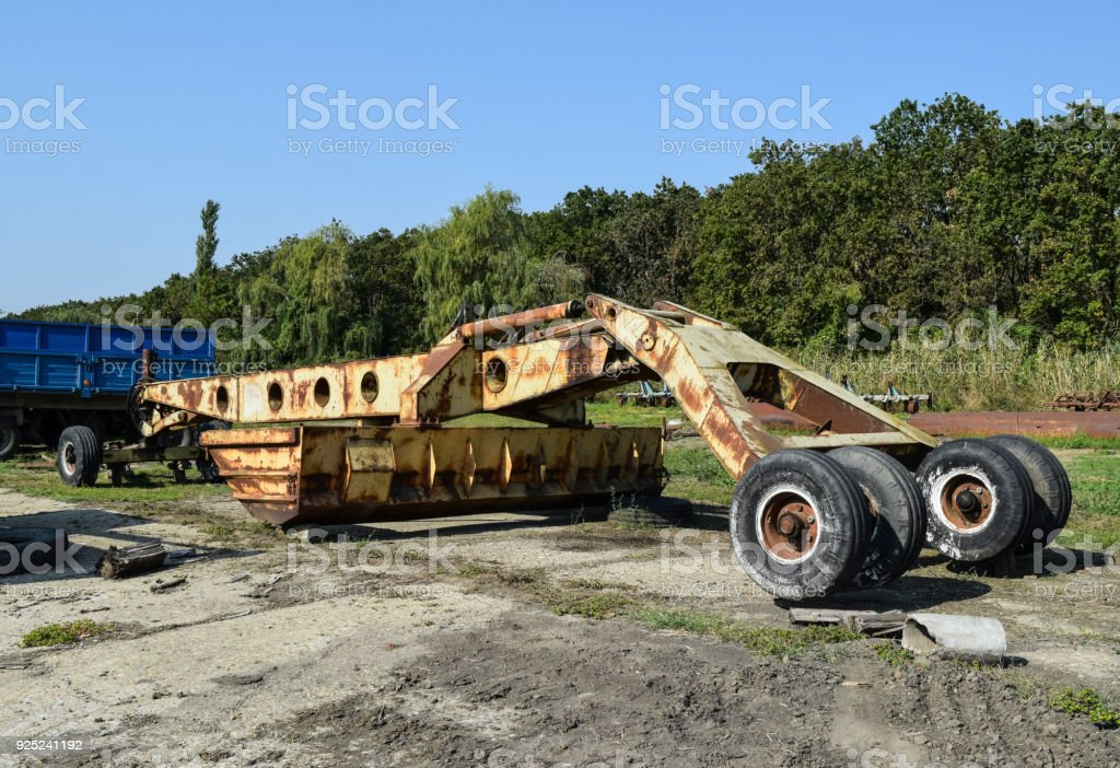 Grader on a trailer for heavy equipment. stock photo