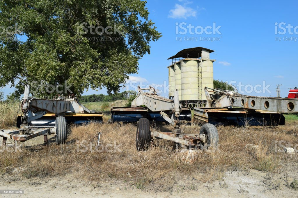 Grader on a trailer for heavy equipment. Trailer Hitch for tractors and combines. Trailers for agricultural machinery stock photo