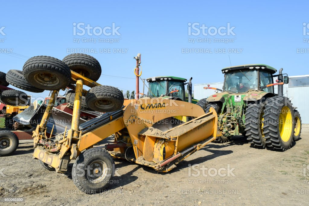 Grader scheduler. A retractor with a grader trailer. stock photo