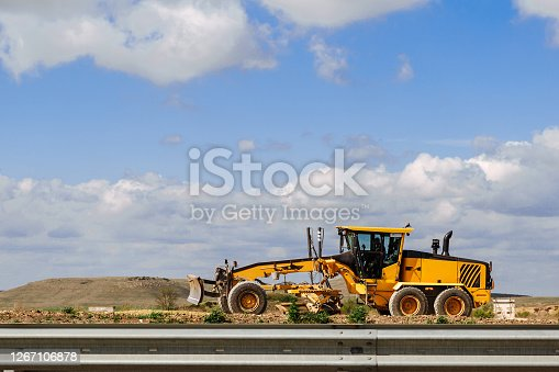 Grader yellow. Grader road construction, industrial machine for the construction of new roads.