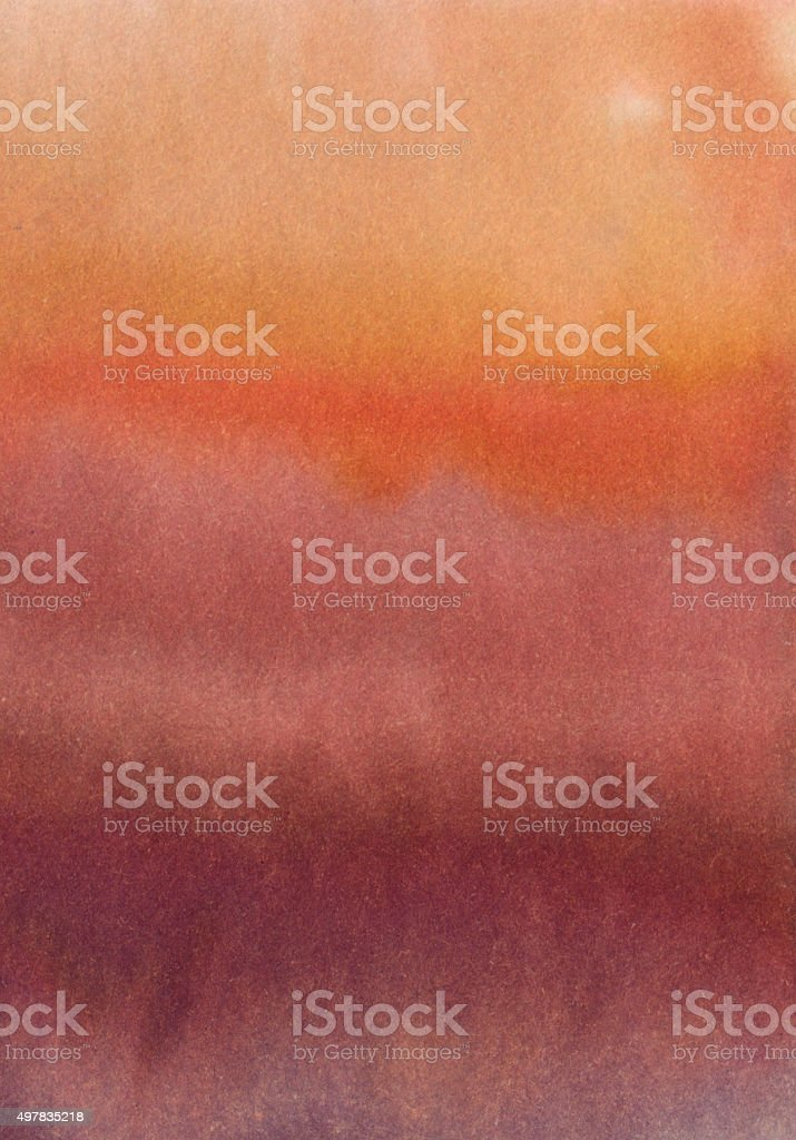 Gradient of red and orange shades hand painted on paper stock photo
