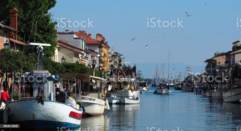 Grado, Italy. Activities in the fishing port before the summer fishing block for fish species protection royalty-free stock photo