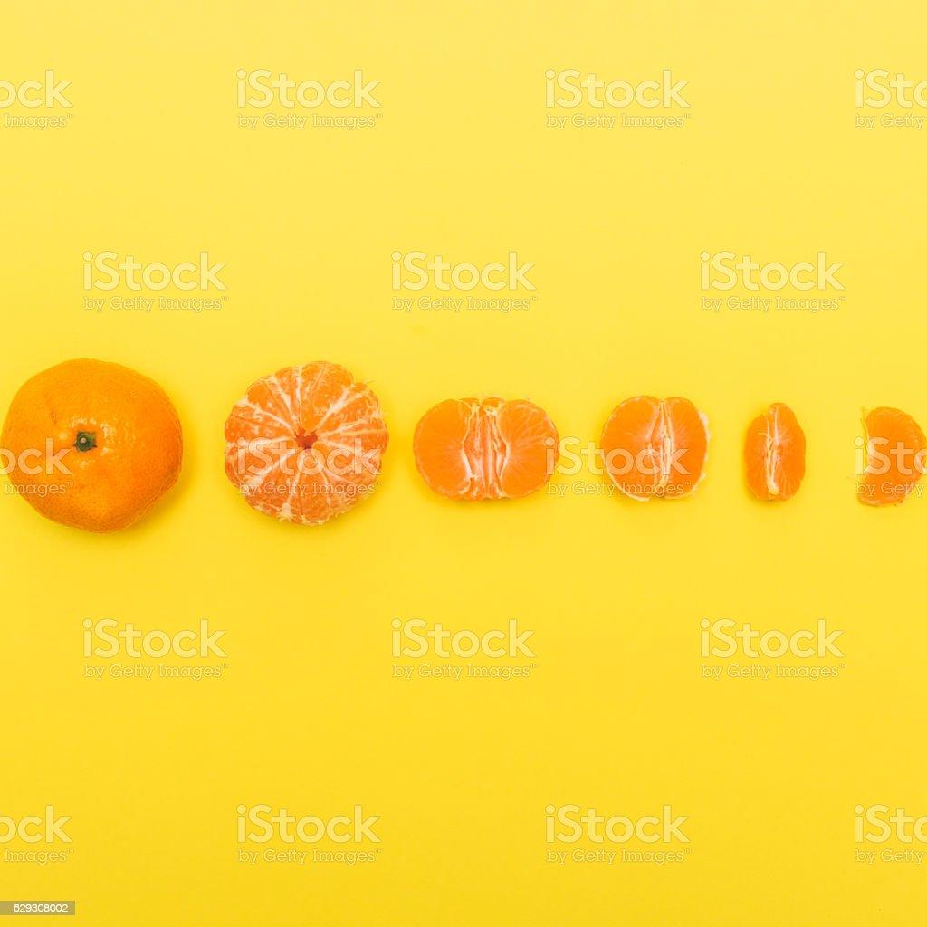 Gradual peeling of tangerine stock photo