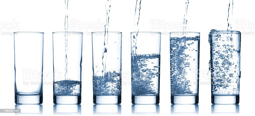 Gradually larger glasses of pure water royalty-free stock photo