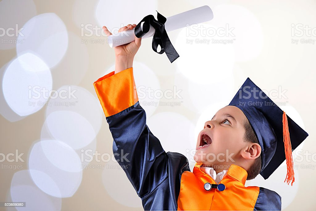 Graduate Boy over Bokeh Background stock photo