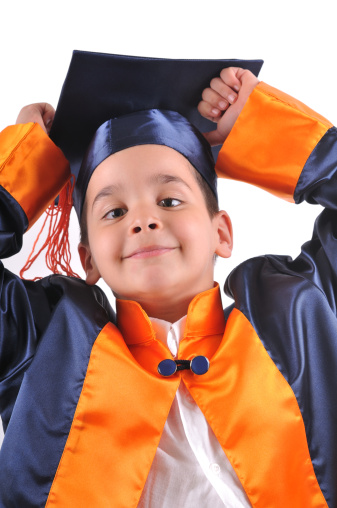 Portrait of Happy Asian boy holding a diploma in graduation day looking at camera.Graduation concept