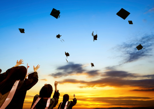 istock Graduate ceremony with students throwing away the hats 185434558