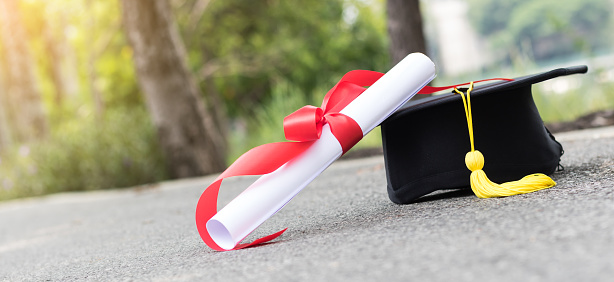 Graduate Hat And Certificated On Street Stock Photo - Download Image Now