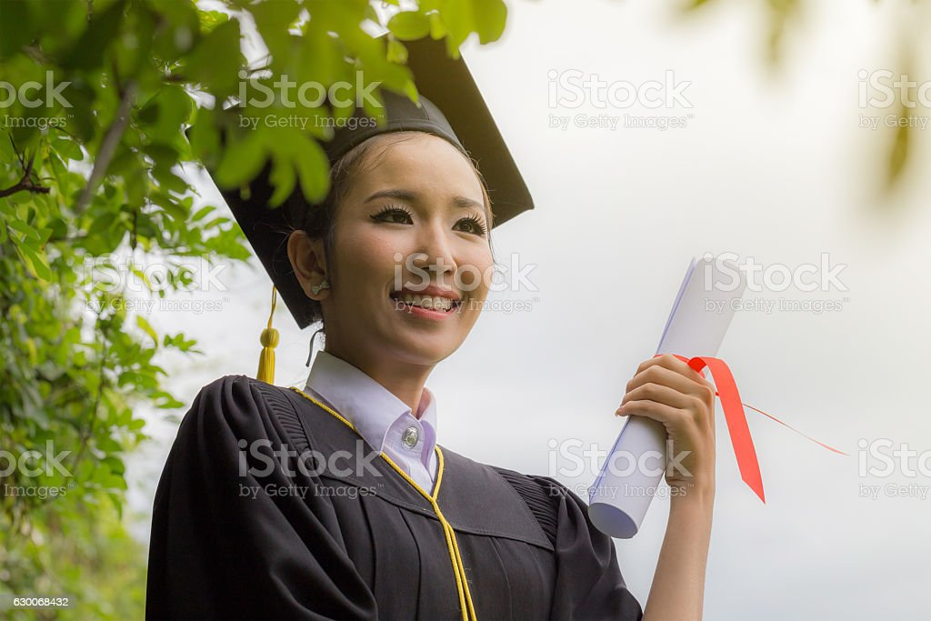 Graduate holding certificate stock photo