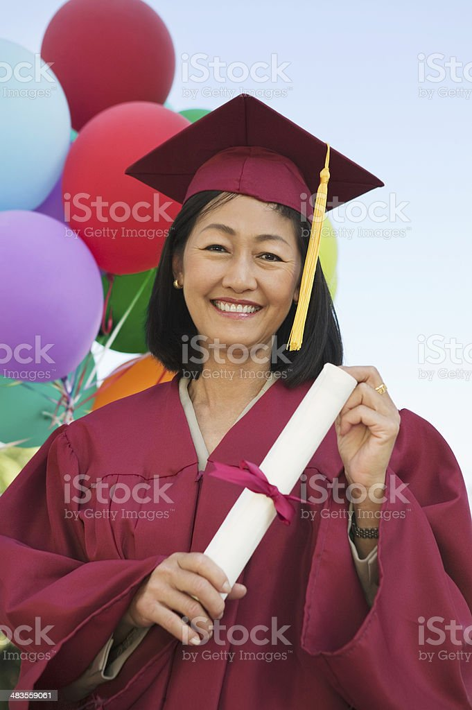 Graduate Holding Diploma stock photo