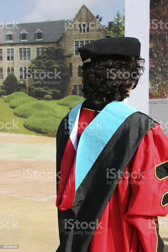 Graduate in gowns royalty-free stock photo