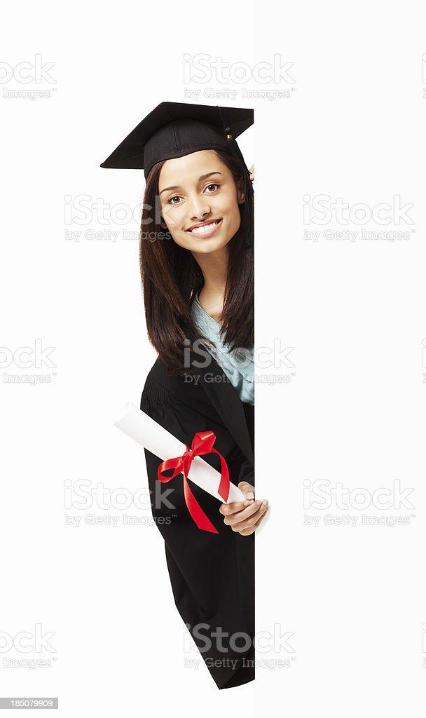 Graduate Looking Around a Corner - Isolated stock photo