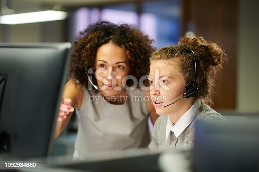 a female call centre worker trains an intern