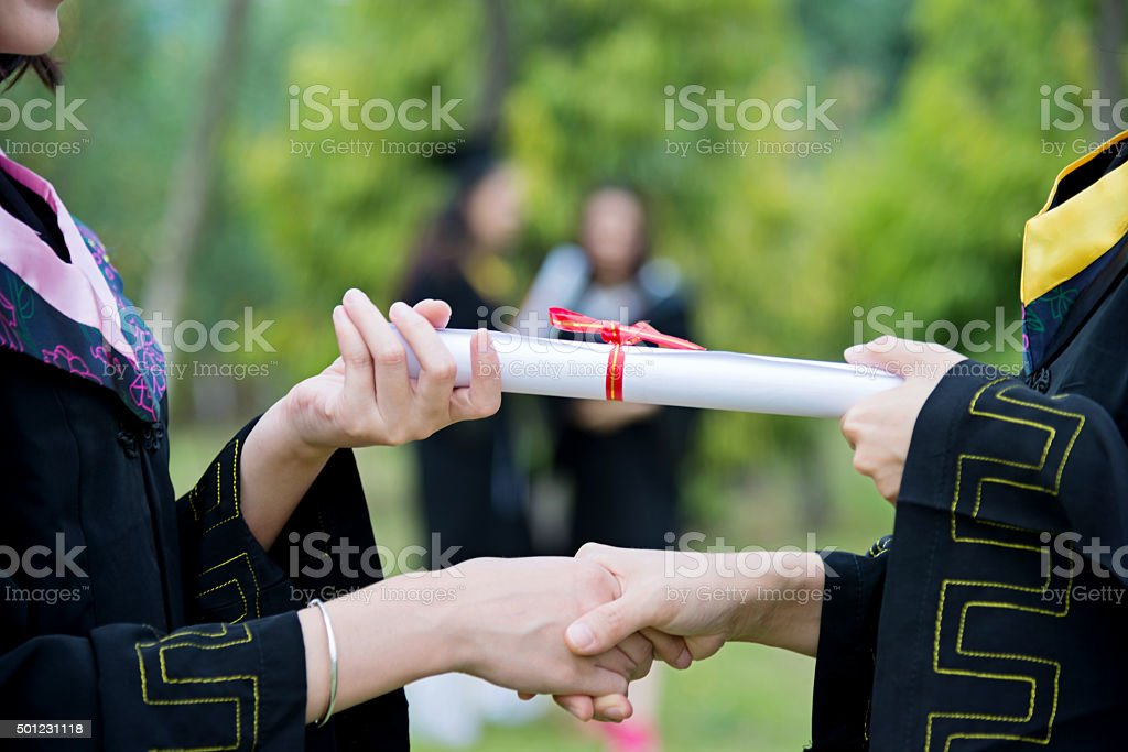 Graduate receiving a degree stock photo