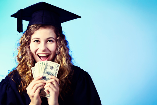 Graduate Smiles Holding Sheaf Of Banknotes Degree Equals Guaranteed Employment Stock Photo - Download Image Now