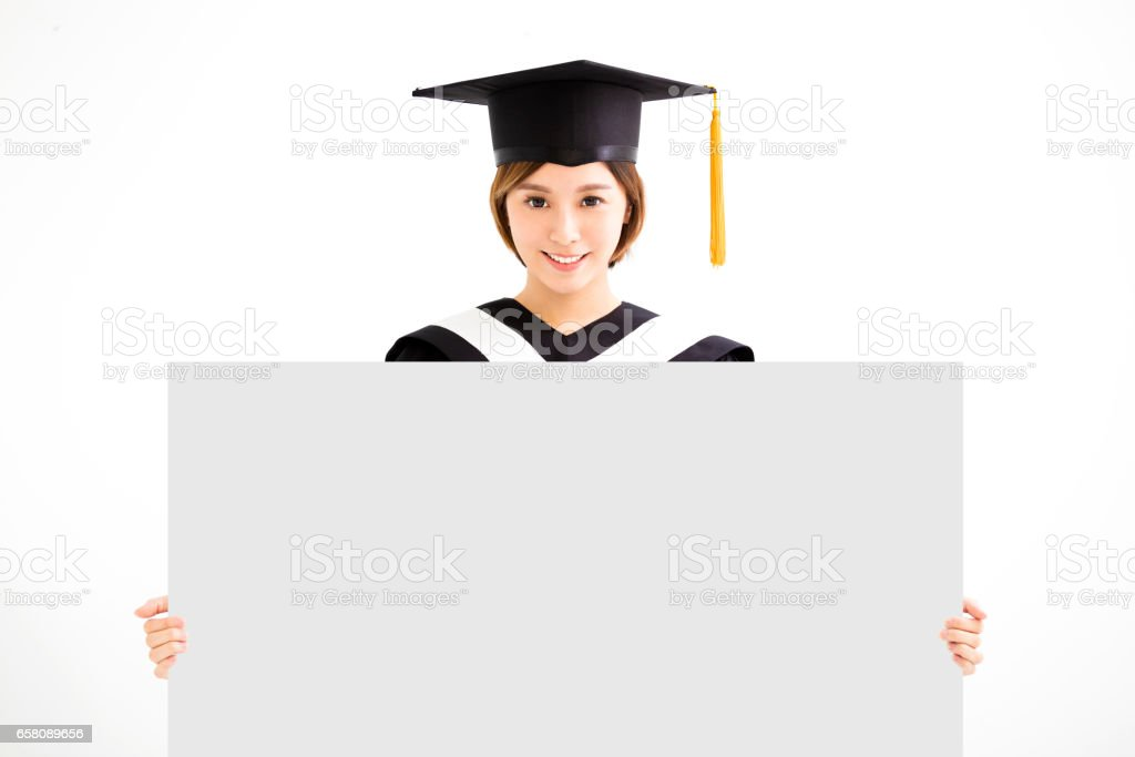 Graduate student girl showing blank placard board royalty-free stock photo