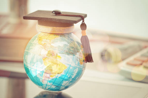 Graduate study abroad concept, Graduation cap on top Earth globe model map with Radar background. Graduate study abroad program and Back to School and Studies lead to success in world wide. stock photo