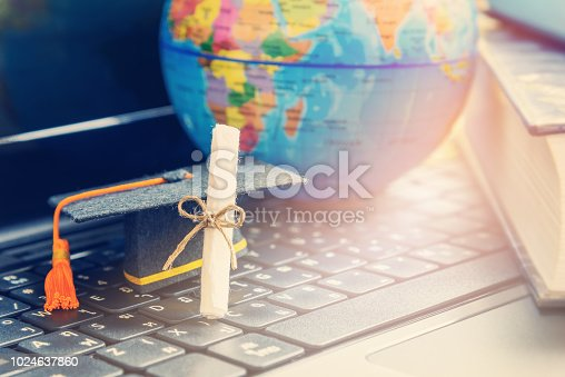 istock Graduate study abroad program concept : Diploma, graduation cap, a globe map and books, depicts knowledge can be learned online anywhere and everywhere, even in universities or campus around the world 1024637860