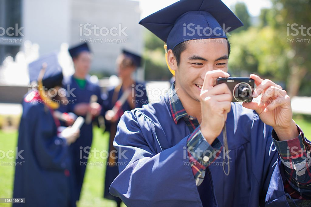 Graduate taking photograph royalty-free stock photo