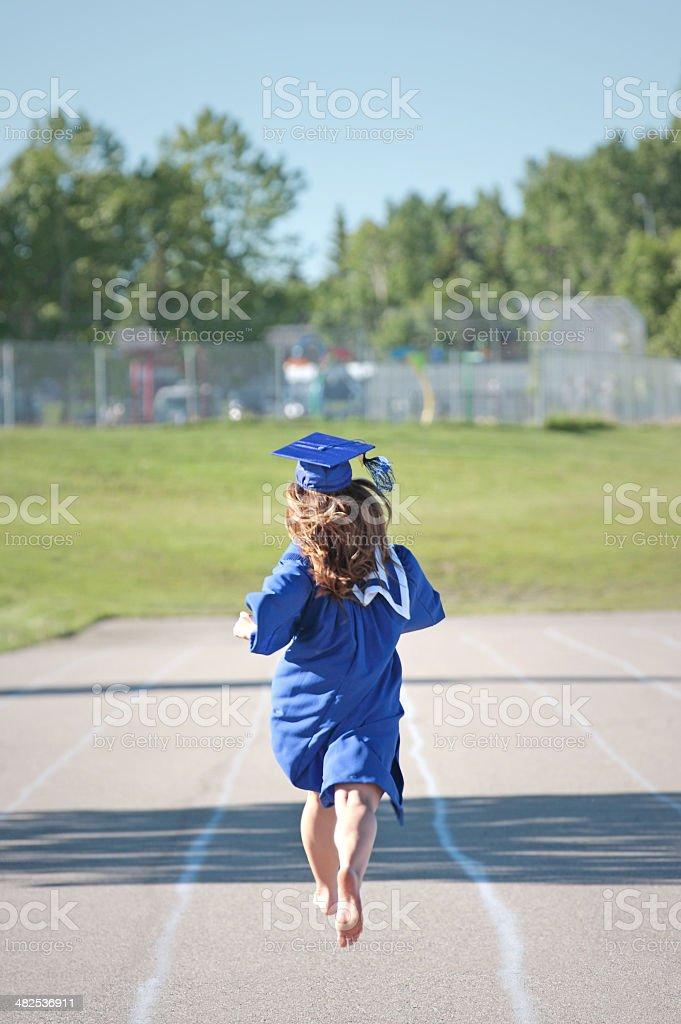 Graduate winning the race royalty-free stock photo