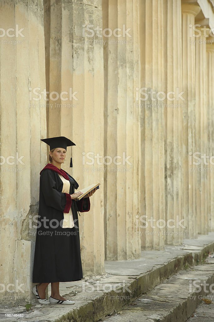 graduate with a book royalty-free stock photo