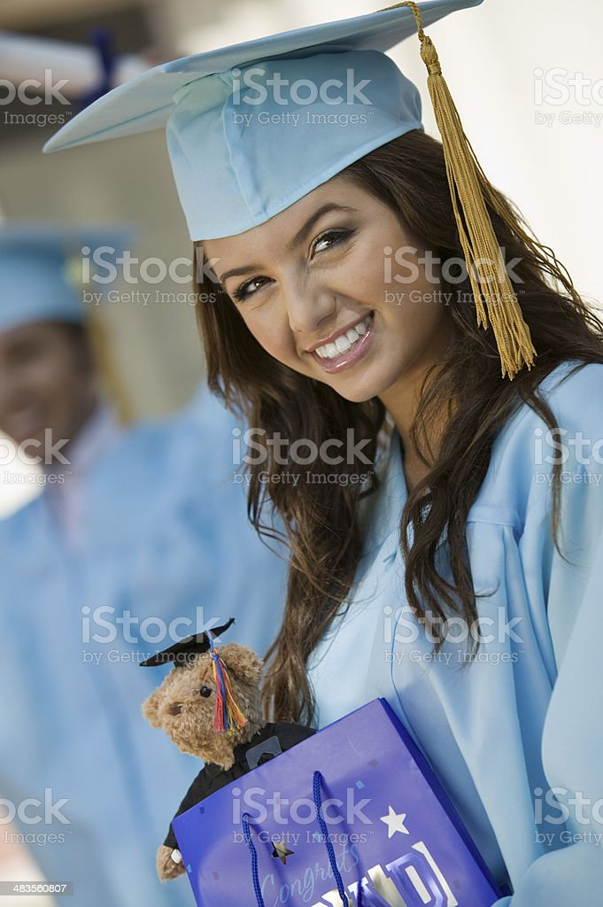 Graduate with Gift Bag stock photo