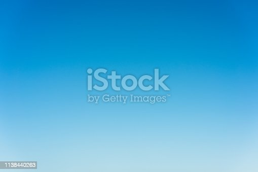 A photo of clear blue sky, just above the horizon, giving a subtle color graduation.
