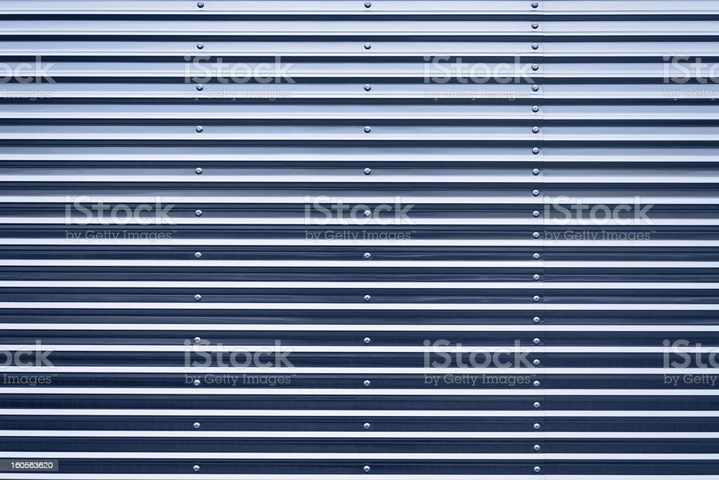 Graduated blue tinted corrugated iron surface stock photo